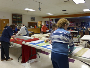 Volunteers make quilt kits for VA Hospital